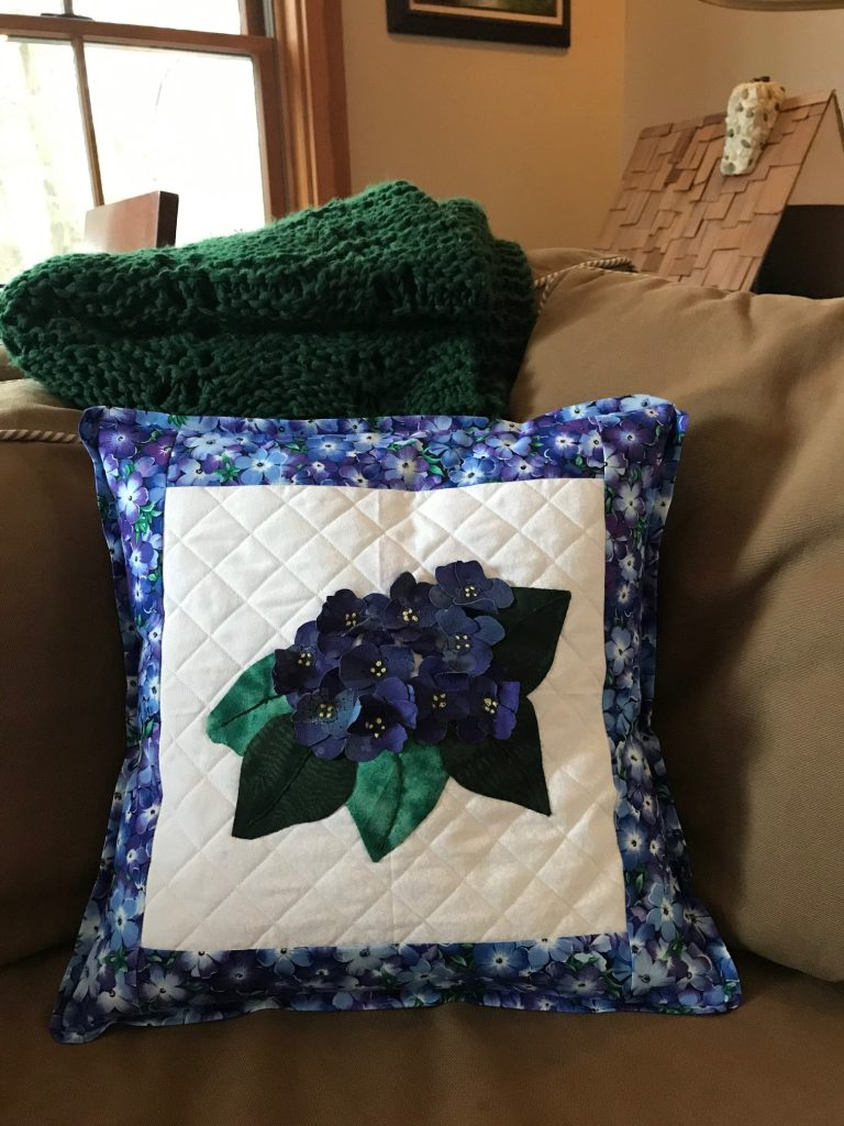 pillow made from Joan Shay's African Violet pattern