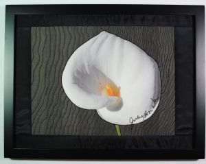 calla lily on black background thread painting