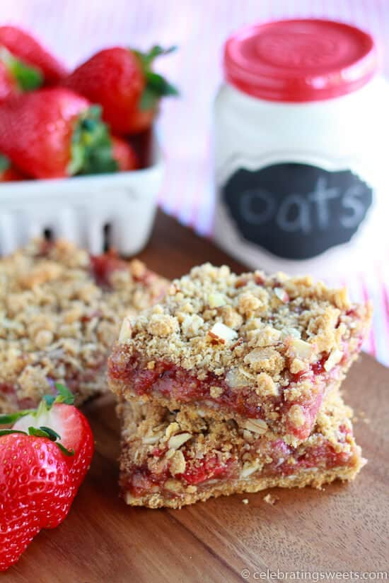 Whole grain oat bars filled with strawberries and topped with an almond crumble