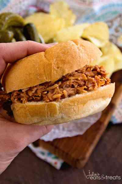 Crock Pot Smokey BBQ Shredded Chicken Sandwiches~ Easy, Shredded Chicken Sandwiches in Your Slow Cooker! Tender, Moist and Delicious Flavored with Liquid Smoke and Smothered in Barbecue Sauce!