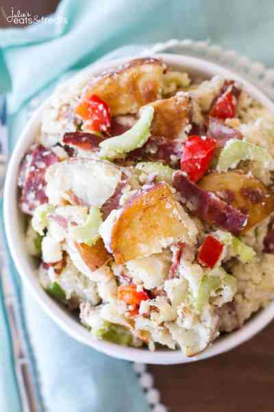This simple potato salad recipe is full of flavor and easily customizable! With roasted red potatoes, bacon, and grilled peppers, this potato salad is irresistible!