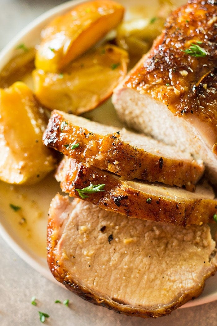 This Maple Pork Loin with Apples and Onions is an easy weeknight meal that feels more like a holiday meal! It's tender, juicy and full of flavor!