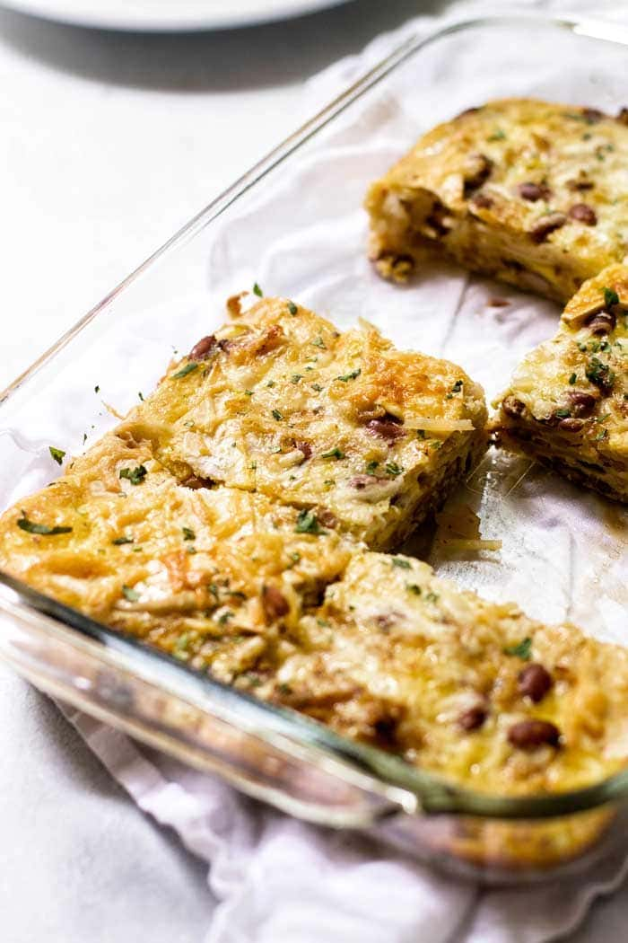 This Enchilada Breakfast Casserole is a Make Ahead Breakfast Casserole so you can sleep in!
