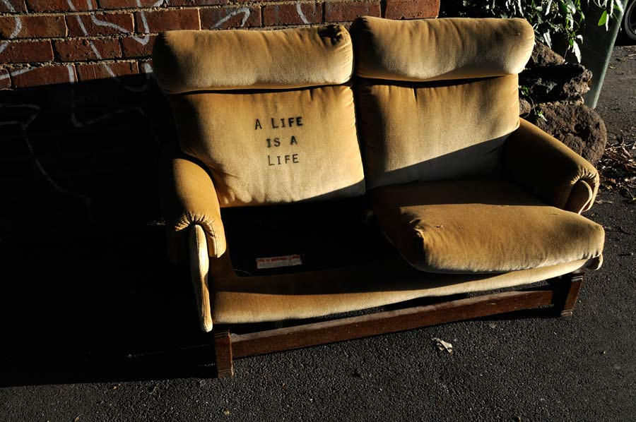 Image of an abandoned couch with