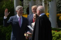 US President Donald Trump watches as Justice Anthony Kennedy(R) administers the oath of office to Neil Gorsuch as an associate justice of the US Supreme Court in the Rose Garden of the White House on April 10, 2017 in Washington, DC and Louise Gorsuch looks on. / AFP PHOTO / Mandel NGANMANDEL NGAN/AFP/Getty Images ORG XMIT: Justice A