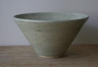 Porcelain bowl with speckled celadon glaze