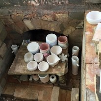 Beginning to stack the kiln.