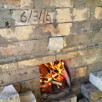 Small kindling is used to start the fire on the firebox floor.