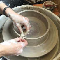 Now I'm throwing an open ring on the wheel. This part will make the walls of the oval dish. Here I'm compressing the rim with a piece of chamois to hopefully prevent any drying cracks.