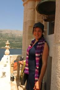 Lauren next to the bell