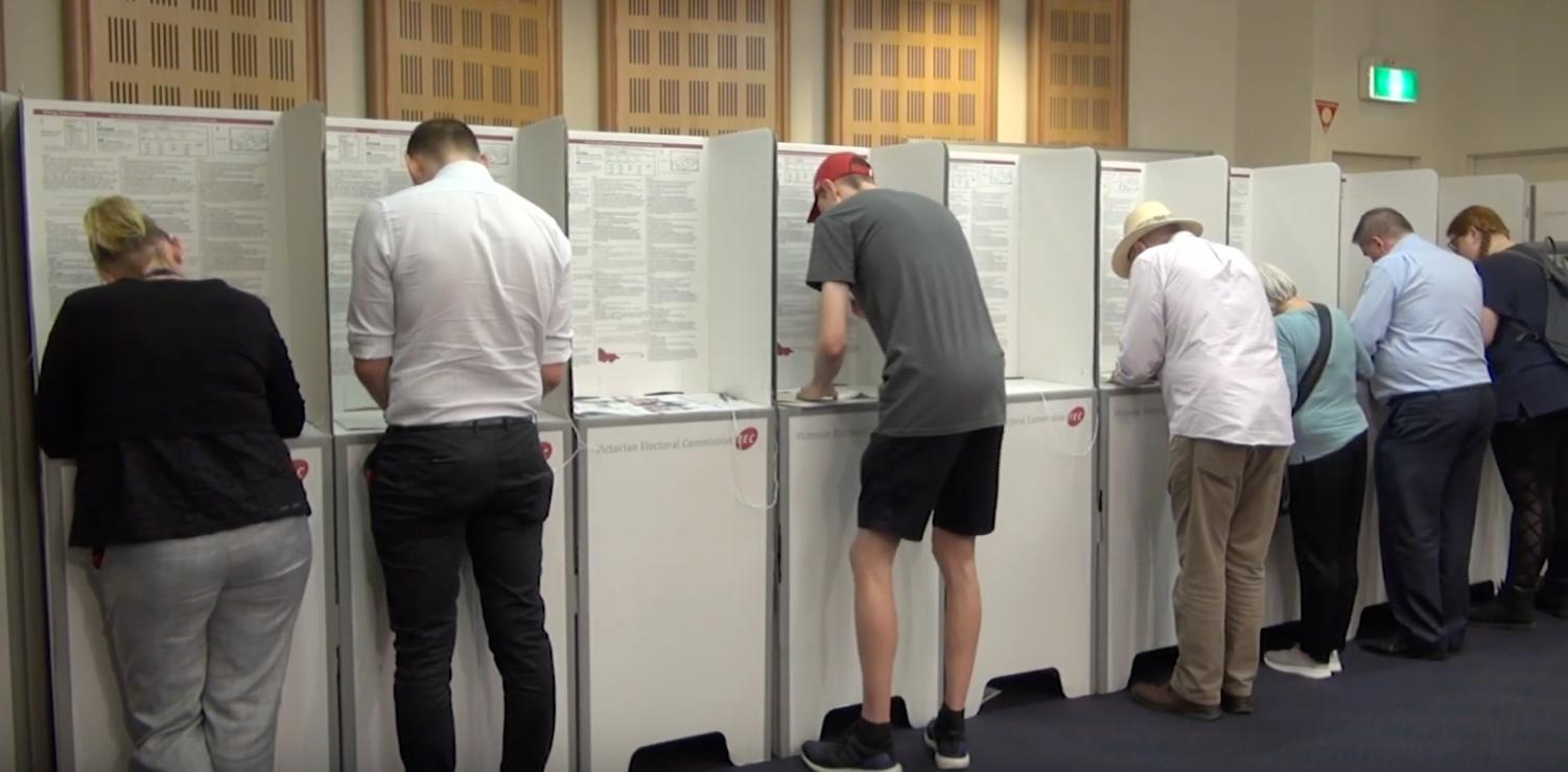 Voters making their choices in a pre-poll booth (Photo: William Ton)