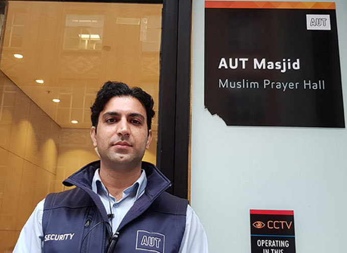 Omer Bin Nasir, a former journalist now AUT security guard and doctoral student ...