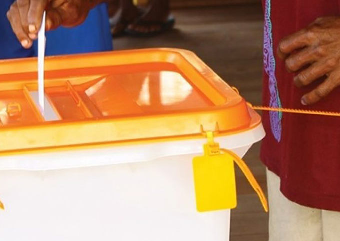 A voter casts his ballot during the 2019 Solomon Islands general election on Wednesday. Image: Island Sun/Wansolwara