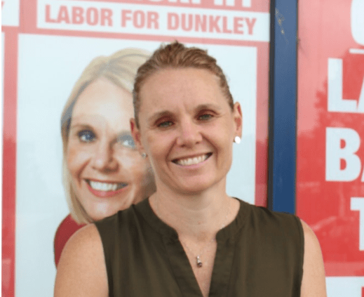 Labor candidate Peta Murphy in front of campaign signage at her campaign office in Carrum Downs