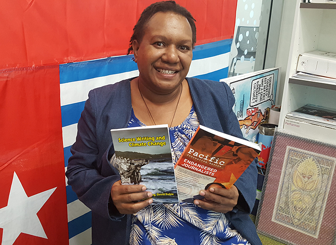West Papuan human rights defender Rosa Moiwend at the Pacific Media Centre this week with publications from the centre. Image: Del Abcede/PMC
