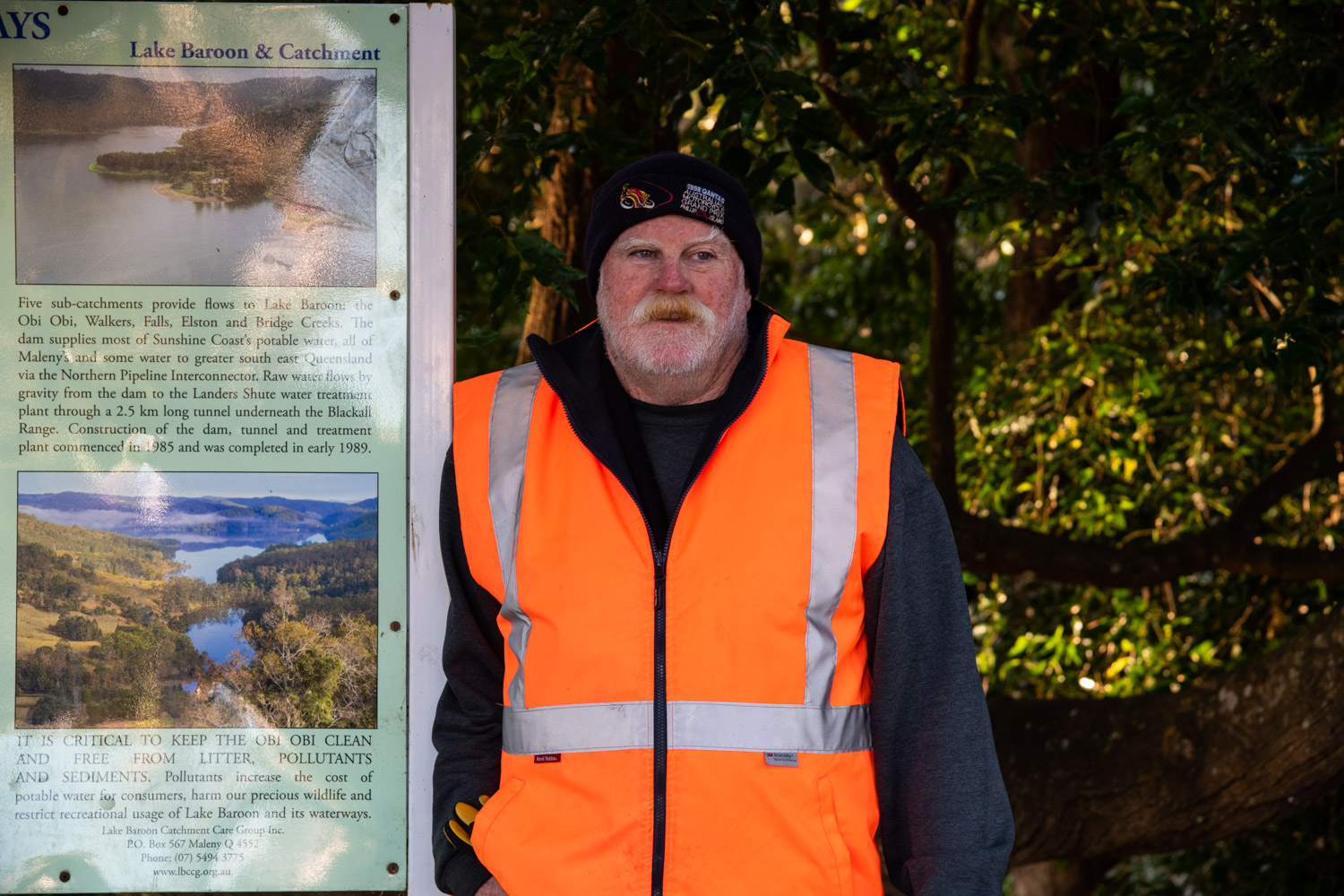 Neil Andison, standing beside an information board, is passionate about keeping the Obi Obi Creek clean.