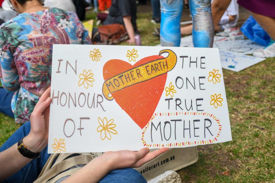 Marchers highlight the heavy toll of the climate crisis on women and girls