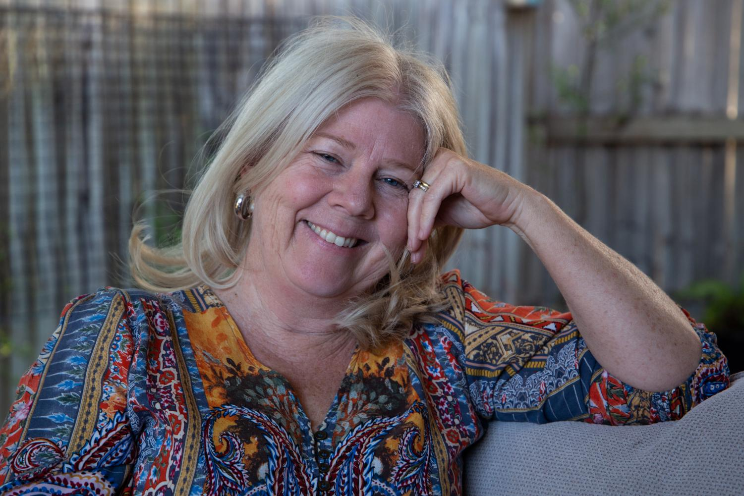 Lindie Rush – aka Eco Granny – relaxes in the backyard of her new house