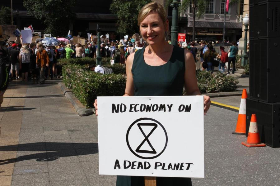 The Greens Senator, Larissa Waters, holding a poster that says: No economy on a dead planet