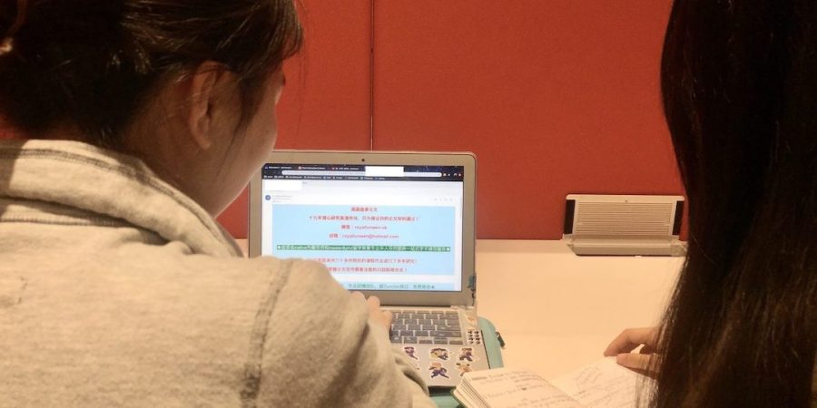 International students at UTS, with one of the spam emails from a contract cheating agency