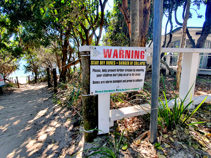 Warning signs at the Clarkes Beach entry point advise people to stay off the dunes to prevent further erosion and to avoid injury.Photo: Ashleigh Hartley