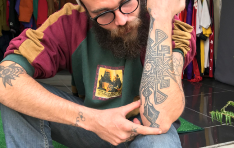 Jaouad describing one of his tattoos. Photo by: Shannon Tucker