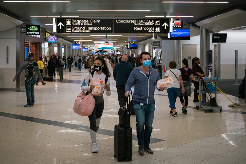 Flyers at Hartsfield-Jackson Atlanta International Airport wearing facemasks on March 6th, 2020 as the COVID-19 coronavirus spreads throughout the United States. Photo: Chad Davis (CC BY-SA 2.0)