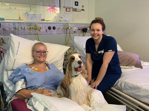 Patient Lisa, Harry the ICU dog and nurse Claire Robertson.