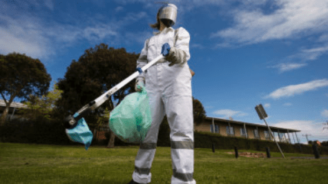 Performance artist Letitia Crispin donned full PPE to draw attention to COVID waste.