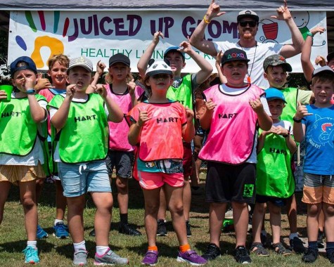 Grom session: Children in the Juiced Up Groms program are outside and having fun