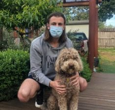 """Mitchell Atanasovski pictured with his canine companion, Archie, said """"my dog helped me through my darkest days."""""""