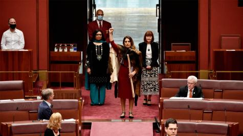 Lidia Thorpe enters the Senate chamber for the first time.