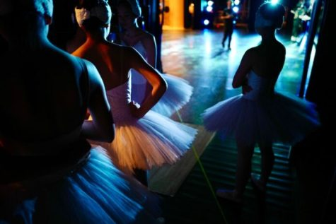 Young girls in tutus waiting to go on stage. Photo: Kazuo ota on Unsplash