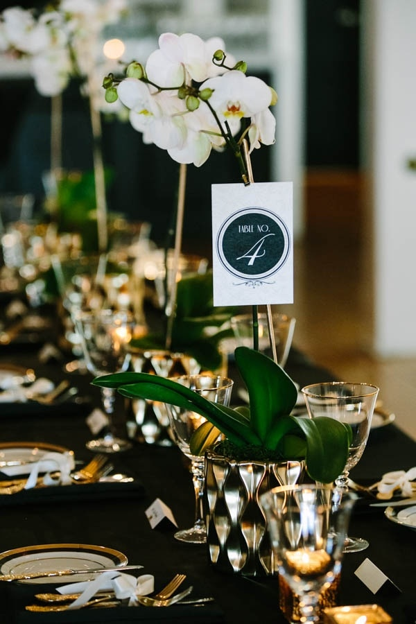 Black White And Gold Tablescape With Orchid Centerpieces