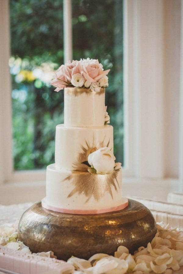 Three Tier White Wedding Cake With Blush Roses And Gold Paint