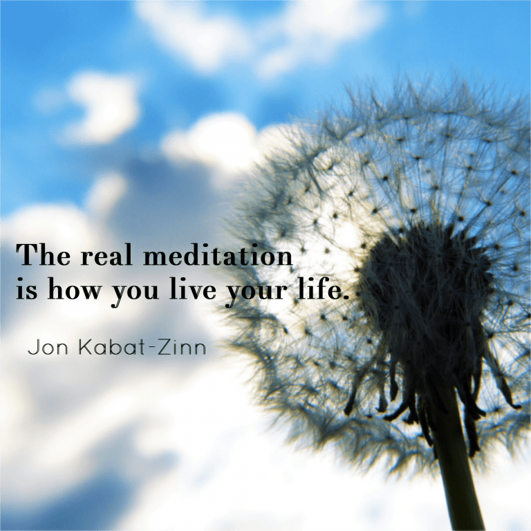 Dandelion seed against a blue sky with affirmation by Jon Kabat-Zinn - The real meditation is how you live your life.