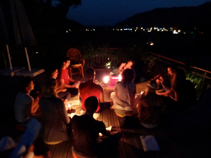 You can see lights from the town twinkling above our kirtan fun.