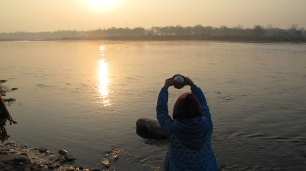 Purifying sight looking through a stream of water at the early morning sun on the Ganga. Photo by Mandakini Puri
