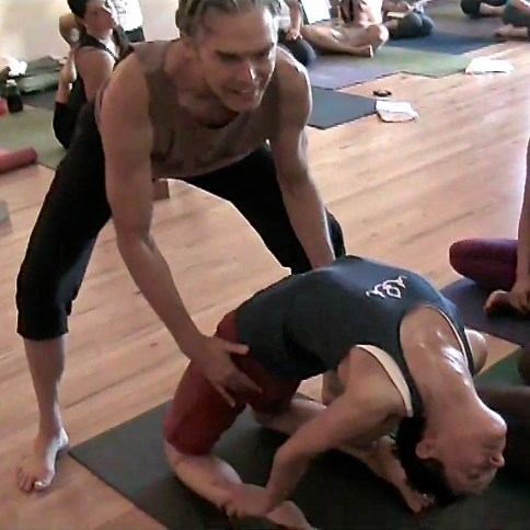 Richard assisting me in laghu vajrasana. Photo by Chris Croft