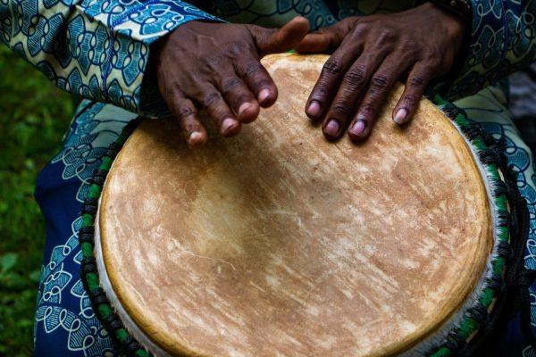 Hands drumming image by photographer Caleb Toranzo via Unsplash