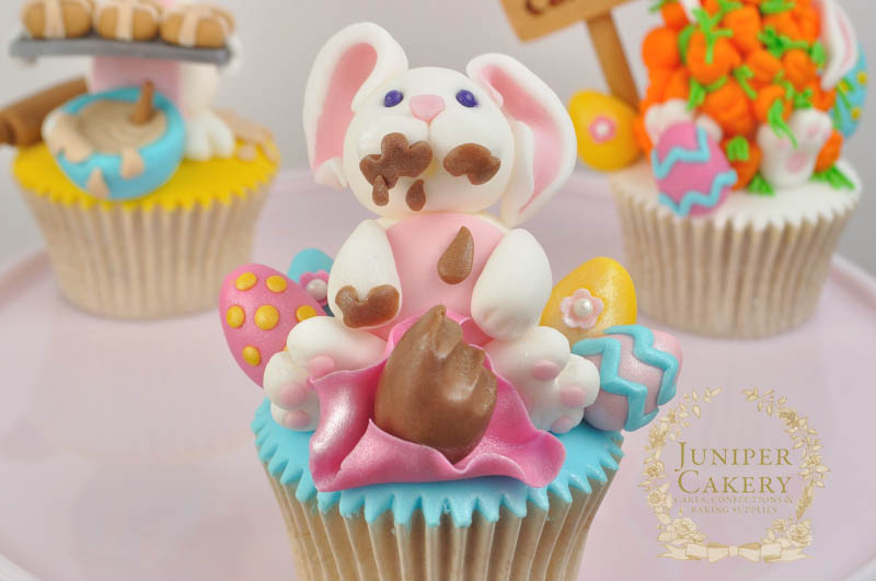 Cute Easter Bunny with Chocolate Eggs Cupcake by Juniper Cakery