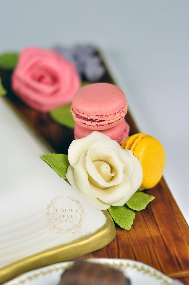 Recipe book cake with macarons and roses by Juniper Cakery