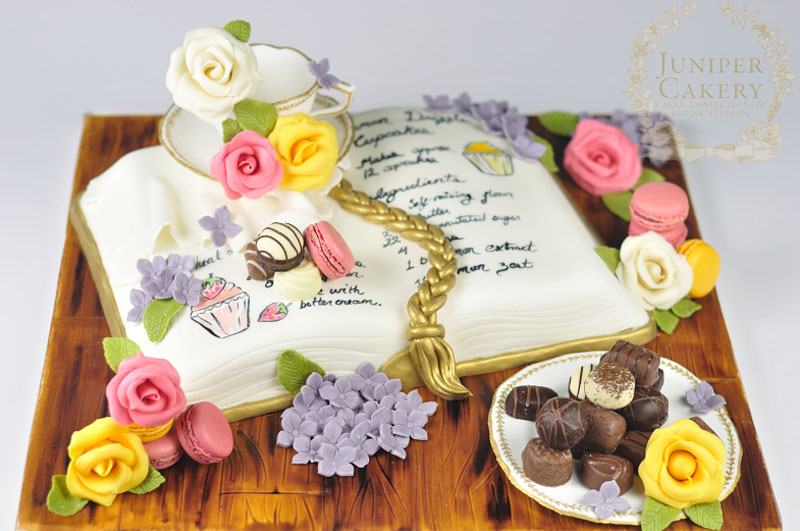 Tea, macarons and recipe book cake by Juniper Cakery