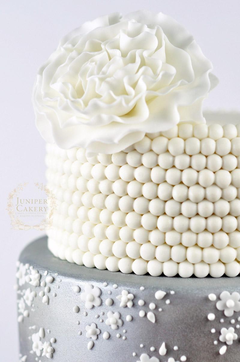 Pretty lace wedding cake by Juniper Cakery