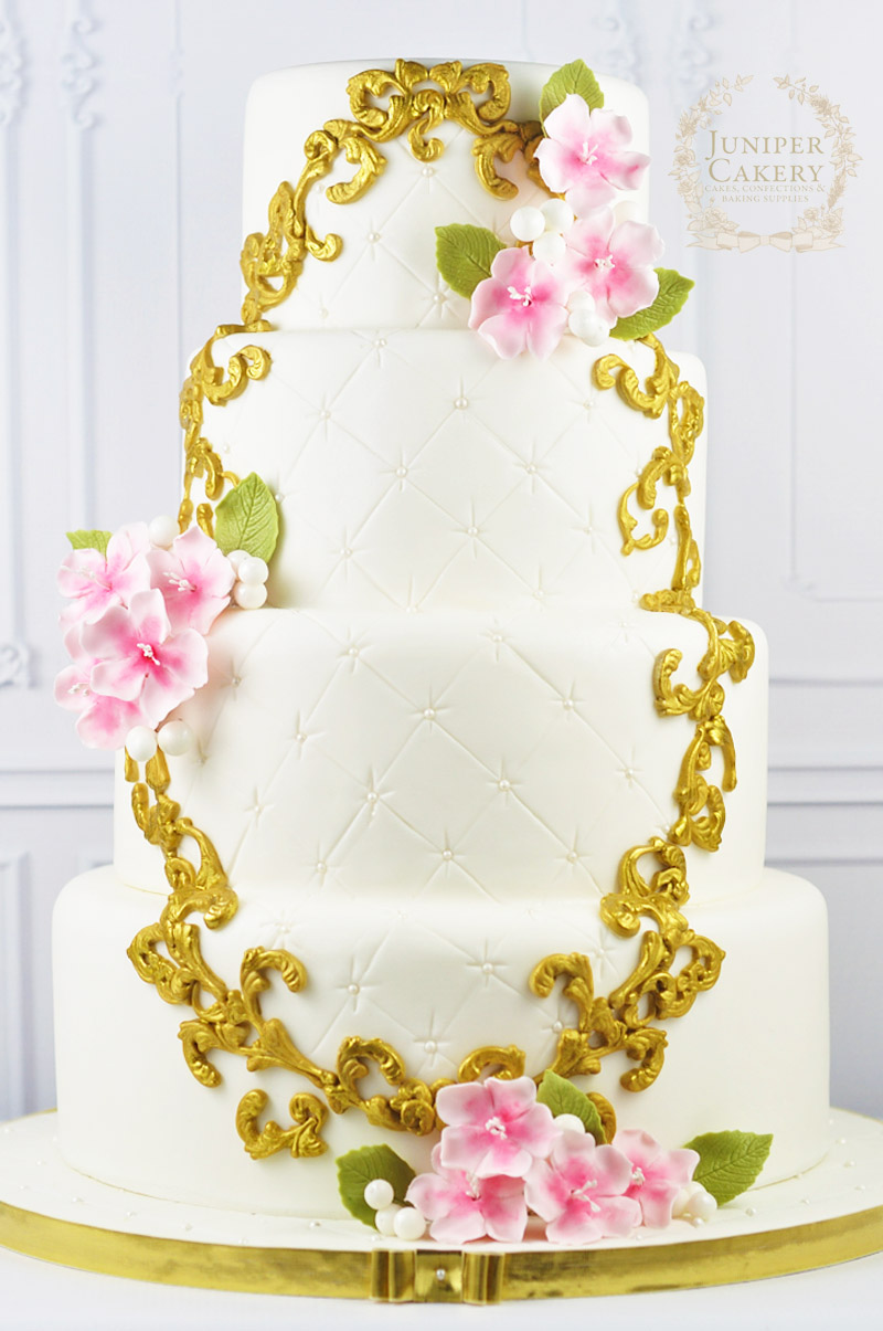 Sweet cherry blossom wedding cake with gold painted frame by Juniper Cakery