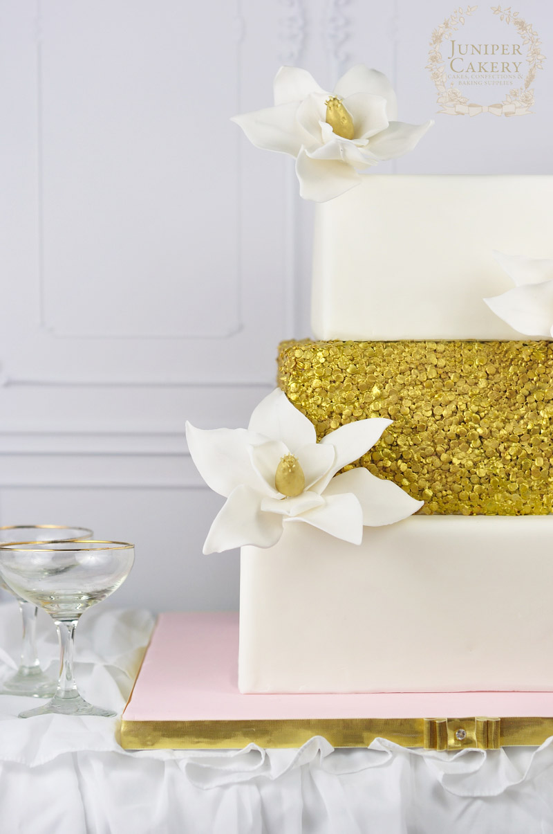 Magnolia and Sequin Wedding Cake by Juniper Cakery