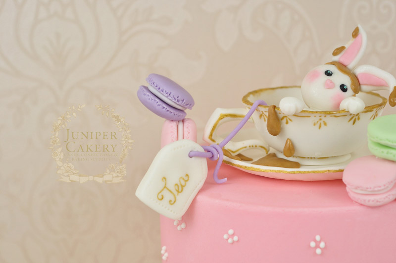 Cute tea drenched fondant rabbit topped cake by Juniper Cakery