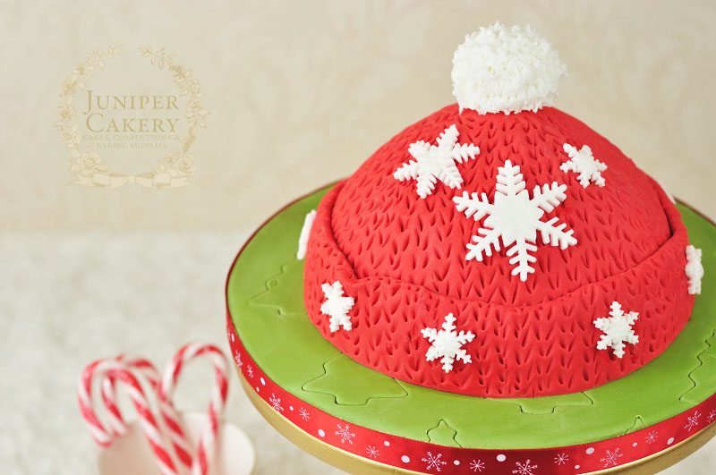 Fun and festive woolly hat cake tutorial by Juniper Cakery