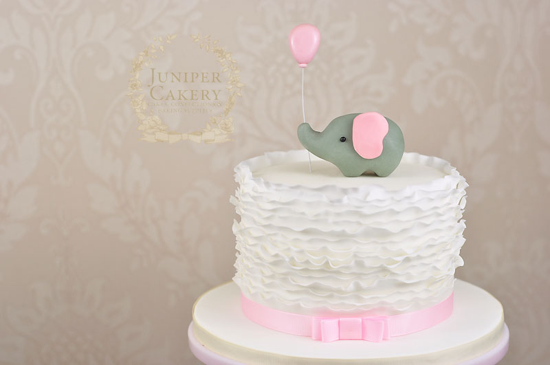 Cute baby shower cake with fondant ruffles and elephant by Juniper Cakery
