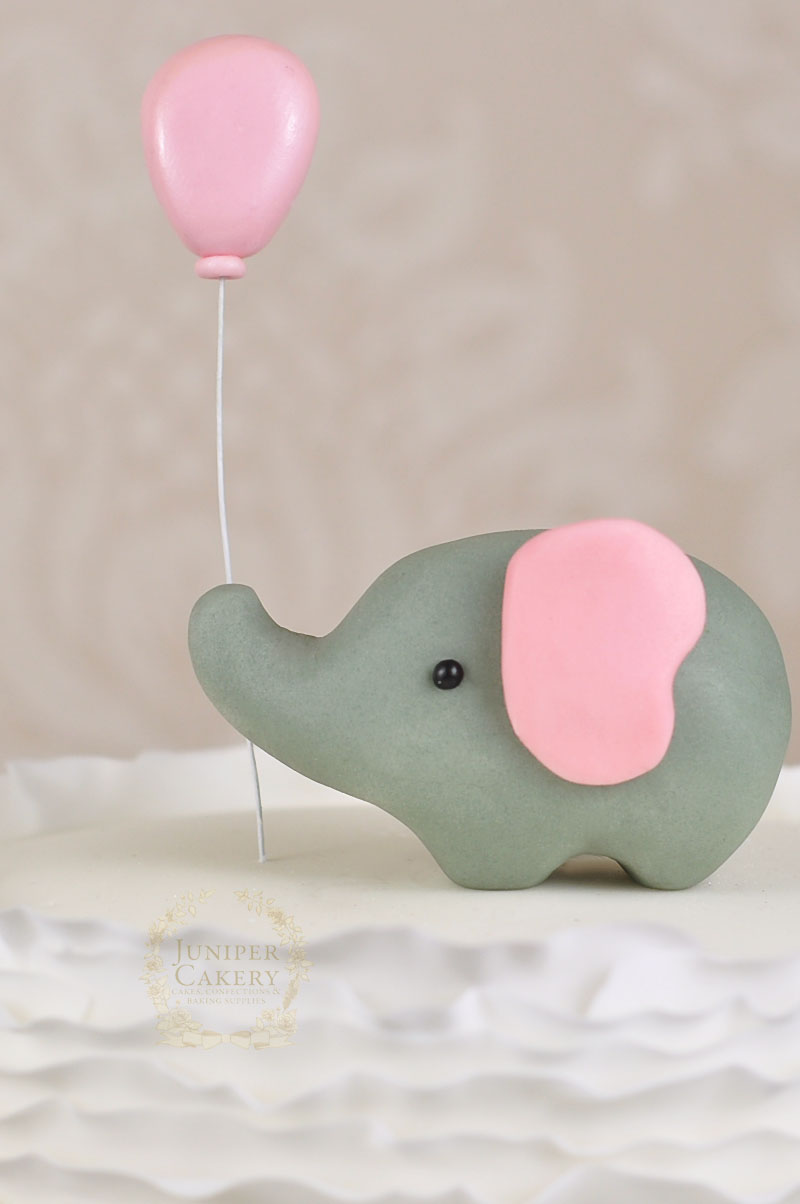 Adorable fondant elephant cake topper with balloon by Juniper Cakery